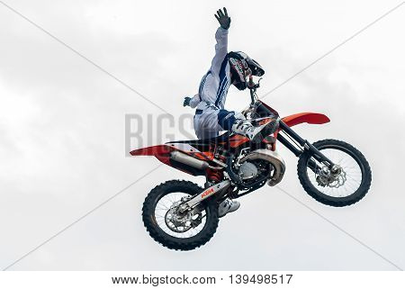 Tyumen, Russia - June 10, 2009: Red Bull X-Fighters Exhibition Tour. Freestyle Motocross. Sportsman carries out trick