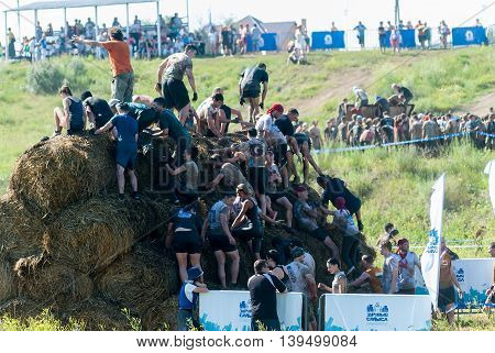 Tyumen, Russia - July 9, 2016: Steel Character extrim race on Voronino Hill. Obstacle mow