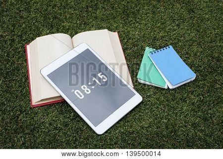 Book Tablet Grass Network Morning Concept