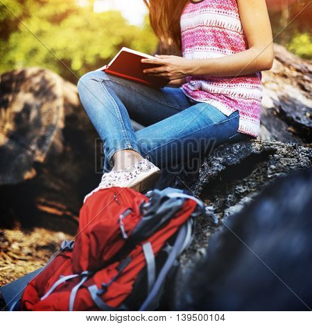 Young Hiker Reading Relaxation Concept