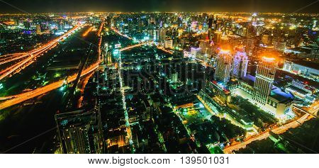 view over the big asian city of Bangkok , Thailand at nighttime when the tall skyscrapers are illuminated