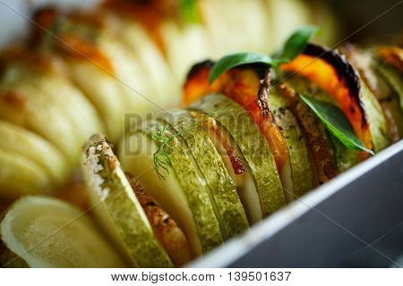 Baked zucchini stuffed with vegetables and bacon