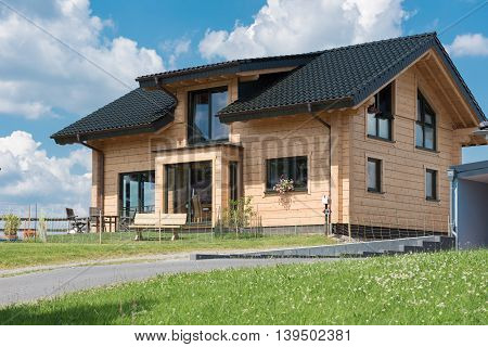beautiful prefabricated house with meadow under blue sky