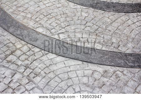 Perspective View of Monotone Gray Brick Stone on The Ground for Street Road. Sidewalk Driveway Pavers Pavement in Vintage Design Flooring Square Pattern Texture Background
