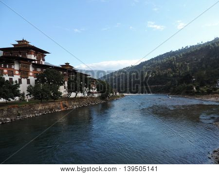 Bhutan buildings and landscape with river and mountain