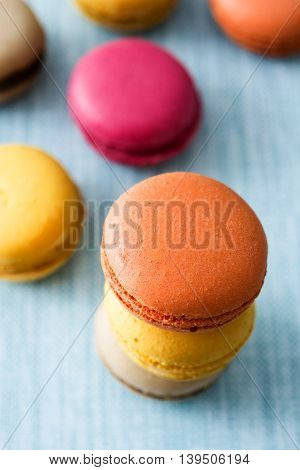 Some sweet colored macaroons on blue background
