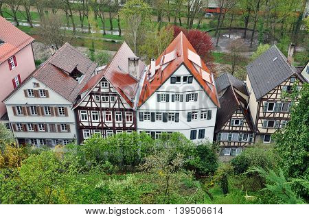 Top view of typical half-timbered houses standing in the row with gardens in the foreground. Baden-Wurttemberg Germany.