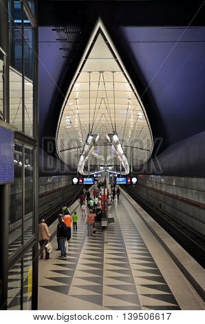 Munich, Germany - April 22, 2014: Interior Hasenbergl underground station in Munich. Curve Futuristic design with lighting on a blue background.