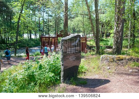 KOTKA, FINLAND - JUNE 26, 2016: People walk to The Russian Emperor Alexander III fishing lodge near Langinkoski Rapid on Kymi River