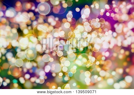 Festive background with natural bokeh and bright lights. Vintage Magic background with colorful bokeh. Spring Summer Christmas New Year disco party background.