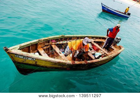 SANTA MARIA CAPE VERDE - DECEMBER 15, 2015: Fishermen returning home after catching the tuna fish