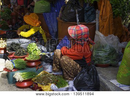 Busan South Korea April 8 2016 Merchants offer their wares at an outdoor market in Busan South Korea. Editorial Use Only.
