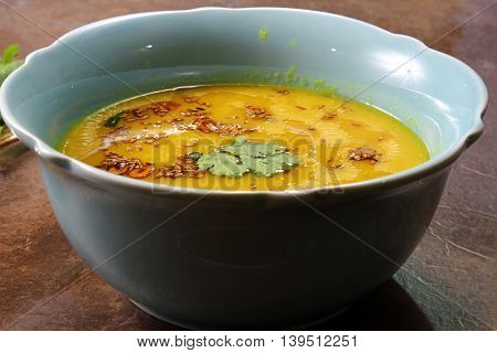 Yellow Lentil soup or Arhar Daal fry with the tadka of cumin seeds garlic and green chilies