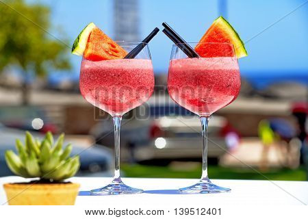 refreshing fruit cockail with watermelon in big glasses for summer parties