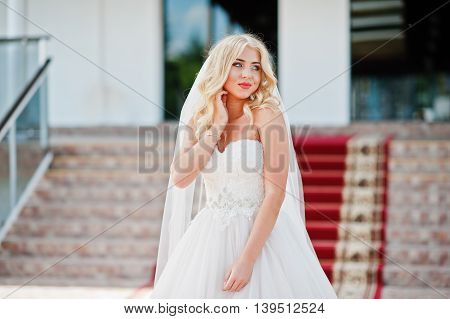 Elegant Blonde Blue Eyes Fashion Bride At Great Wedding Hall On Red Carpet