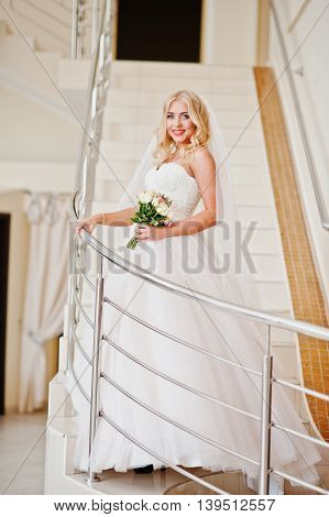 Elegant Blonde Blue Eyes Fashion Bride At Great Wedding Hall On Stairs With Rail