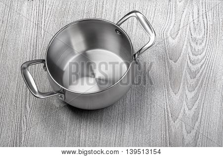 empty cooking pot on rustic wooden background top view composing copy space