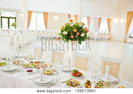 Bouquet of flowers on wedding table at wedding