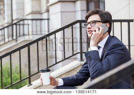 Businessman With Coffee On Phone