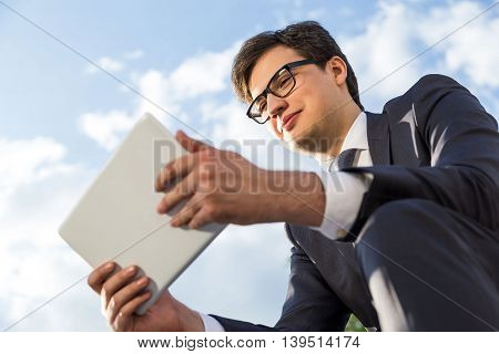 Happy Businessman Using Tablet Outside