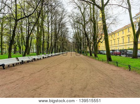 In the Alexander Garden in St. Petersburg in the spring rainy day