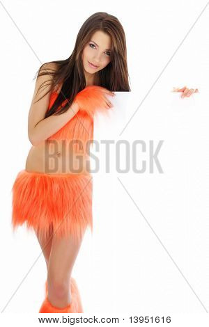 beautiful smiling girl in orange costume holding a blank billboard.