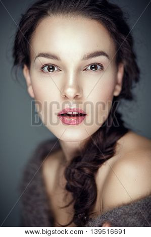 Fashion portrait of gorgeous young brunetee woman.Flirt expression. Shallow depth of field