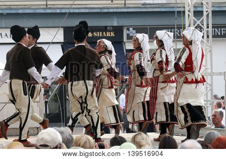 ZAGREB, CROATIA - JULY 22: Members of folk group Etnos from Skopje, Macedonia during the 50th International Folklore Festival in center of Zagreb, Croatia on July 22, 2016
