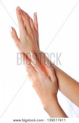 Beautiful female hands isolated over white background