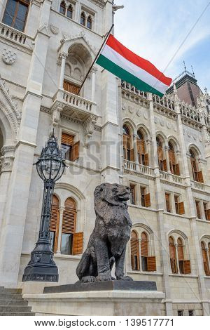 Flag of Hungary an entrance to the Hungarian Parliament in Budapest.