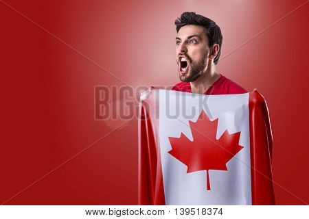 Athlete holding the flag of Canada