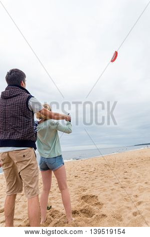Coach Teaches Girl Control The Kite