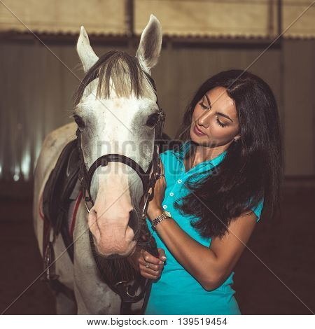 Portrait of beautiful smiling woman with a horse