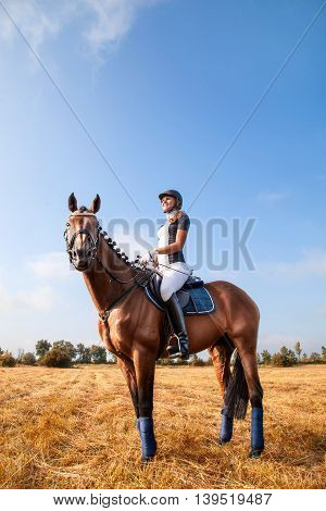 Beautiful Young Horsewoman Sitting On A Horse.