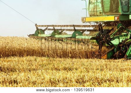 Combine harvester machine tractor in agriculture field taken closeup.