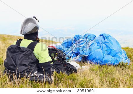 Paraglider Resting Before The Flight On The Grass