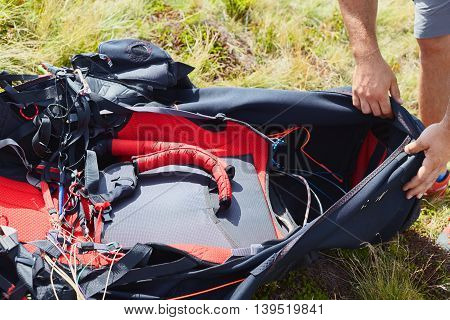 Paraglider Checking Harness Before Flight.