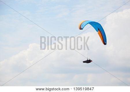 Paraglider Is Flying Over The High Mountains.