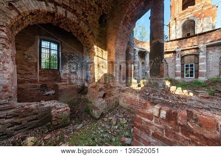 The brick ruins of the interior of an abandoned temple.
