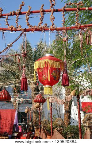 Colourful Chinese lantern with fringe decorating the yard