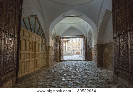 Interior of a passageway with an arch.