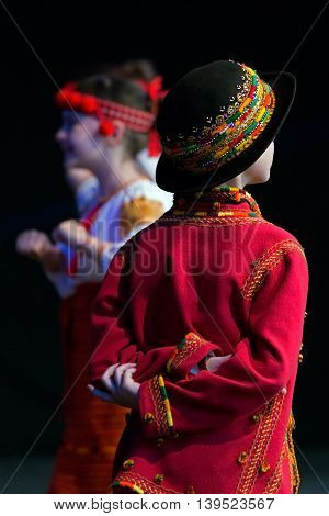 ROMANIA TIMISOARA - JULY 9 2016: Child Ukrainian dancers in traditional costume present at the international folk festival
