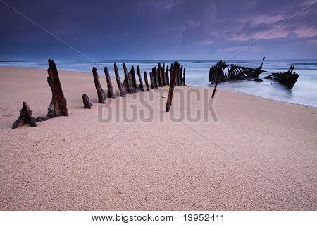 Wreck On Australian Beach At Dawn
