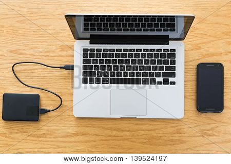 A laptop computer with a portable hard drive.
