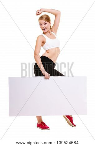 Fitness and health lifestyle advertisement. Young woman girl holding presenting blank empty banner ad copyspace isolated on white background.
