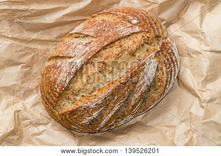 closeup of sourdough loaf on paper bag