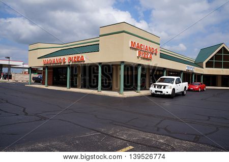 SHOREWOOD, ILLINOIS / UNITED STATES - AUGUST 30, 2015: One may eat pizza at Maciano's Pizza restaurant, in a Shorewood strip mall.