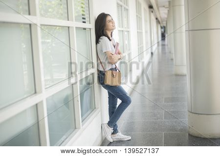 A portrait of an Asian university student on campus
