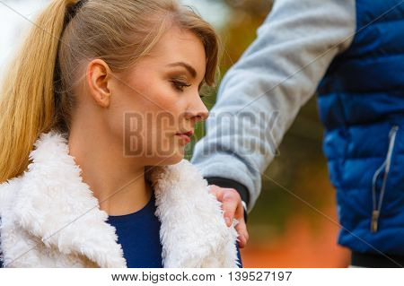 Sad Young Girl Sit Outdoors With Friend.