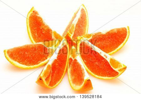 Orange cut in slices with white background